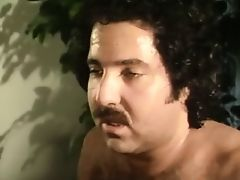 Raven Richards gives Ron Jeremy a blowjob